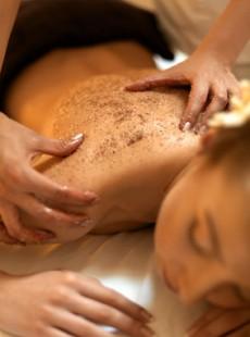 Body Scrub. Beautiful Blonde Gets a Salt Scrub Beauty Treatment in the spa Salon
